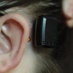 Cochlear BP100/BAHA3 processor on abutment with eyeglasses