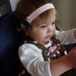 Ally wearing the Cochlear BP100/BAHA3 soft band head band sound processor