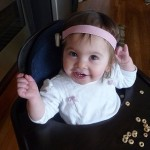 Ally wearing the Oticon Ponto Pro sound prcessor on a soft band head band