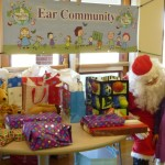 Santa Clause (played by Zach Gulley) hands out presents on December 20th, 2014 at the Toy Drive for Microtia and Atresia kids of Colorado through the Ear Community Organization.