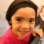 Annika Silang-Ferrer, born with Microtia and Atresia of her right ear, age 4.5, wearing her new Oticon Medical Ponto Plus, fitted on April 16, 2015.