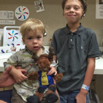 Damian and Michael Mosley, both born with Microtia and Atresia, receiving their newly donated Cochlear Americas Baha 5 processors (August 13, 2015)