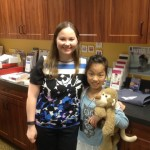 December 22nd, 2015.  Dr. Chelsea McNee with YuXi Sun Todd after being fitted with her newly donated Oticon Medical Ponto Plus hearing devices.