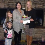 December, 18th 2015.  Julia Patrick of Resort2Kindness presenting Melissa Tumblin a grant check for $10,000 for the Ear Community Organization.  Pictured with her two children, Hailey and Ally (whom Ear Community was founded after).